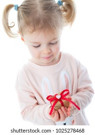 little girl holding a gift mothers day concepts