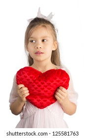 Little Girl Holding Heart-Shaped Pillow Isolated on White