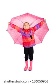 Little girl holding her big pink umbrella like wings