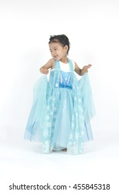 Little girl holding her blue dress,princess of elsa frozen