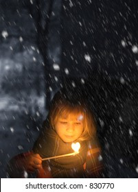 little girl holding match stick during a cold night