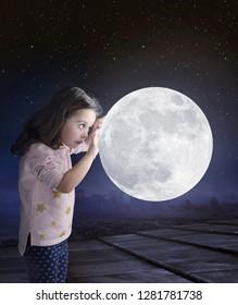 Little girl holding moon