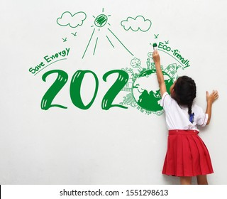 Little girl holding a paint brush painting creative environmental and eco-friendly, Save energy