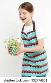 little girl holding parsley