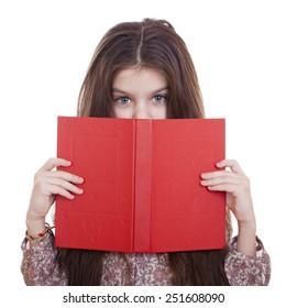 Little girl holding red book, studio on white background