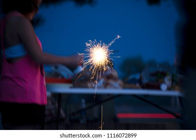 Little girl holding sparkler during July 4th Fourth of July holiday celebration