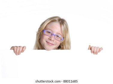 Little girl holding a white panel.