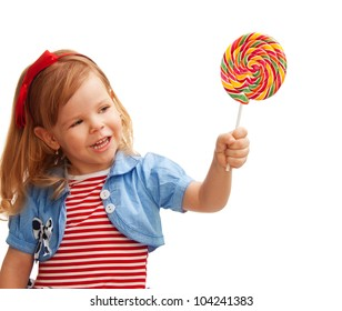 Little girl holds big lollipop in her hand