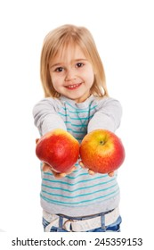 The little girl holds in hand ripe apples on a white background
