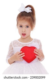 Little girl holds up a heart.Studio photo, isolated on white background.