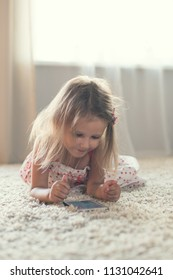Little Girl At Home With Smartphone