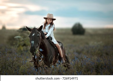 little girl with horse on ranch