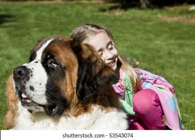 Little Girl Hugging Dog