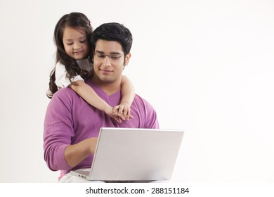 Little girl hugging her father over white background