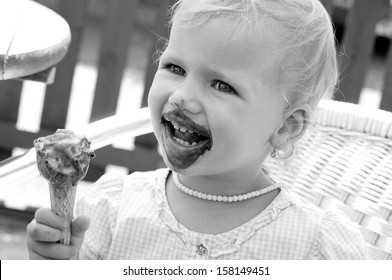 little girl with ice cream - black and white