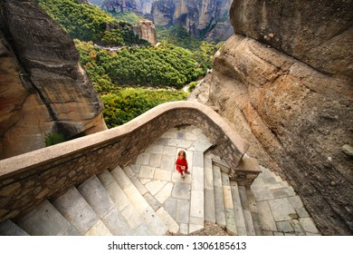 A little girl immersed in the wonderful panorama of Meteora