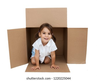 Little girl inside a Box isolated on white background