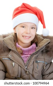 Little girl in jacket and Christmas hat smiling, isolated on white background.