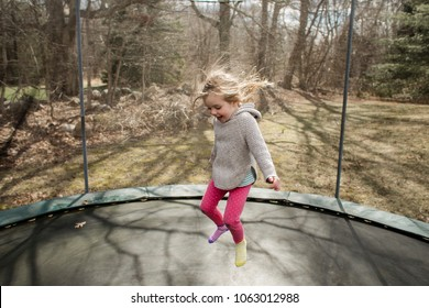 Little girl jumping on a trampoline