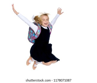 A little girl is jumping and waving her hands. The concept of a happy childhood, outdoor recreation. Isolated on white background.