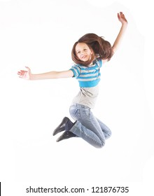 little girl jumps on a white background