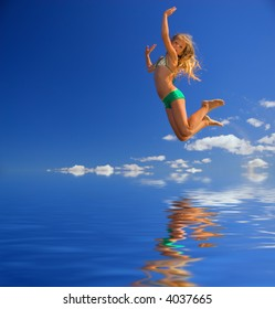 Little girl jumps over water