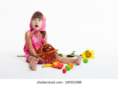 a little girl in a kerchief with a basket of fruit