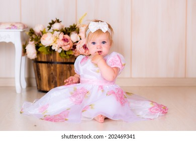 Little girl kid celebrate first Happy Birthday Party with  decor in the beautiful room