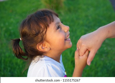 the little girl kisses the old human's hand. Muslims kiss the hand of old people on religious holidays. Victim and Ramadan feast