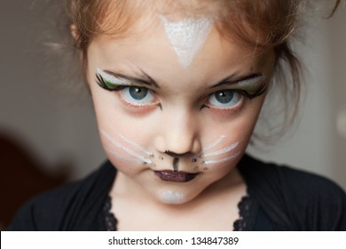 little girl with kitty cat make up