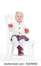little girl in a knitted jacket on a white background