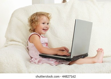 Little girl with laptop at home