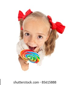 Little girl with large lollipop candy - top view, isolated