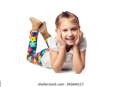 Little girl laughing, lying on his stomach. cut out