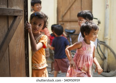 Little girl leaning against door - NEW DELHI; INDIA - MAY 17TH 2015