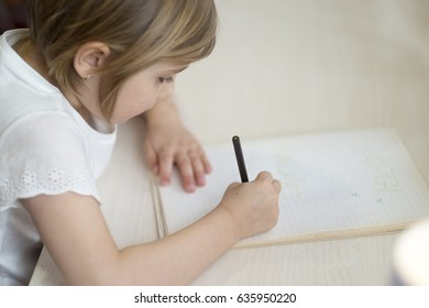 Little girl learn to write