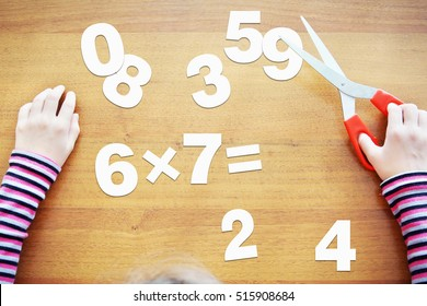 Little girl is learning to multiply. Concept with paper scrapbooking