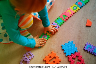 little girl learning numbers and shapes, play with puzzle