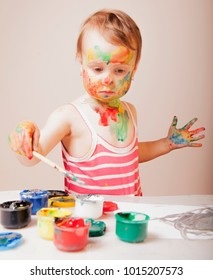 little girl learning to paint (child development in art, training concept)
