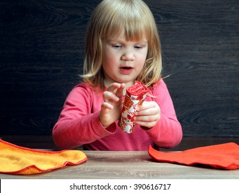 Little girl is learning to put things carefully - towels. Concept - teach your child the accuracy, accustom to order