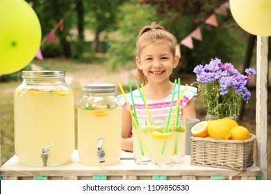 Little girl at lemonade stand in park
