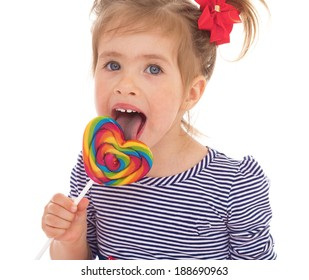 little girl licking a lollipop.Isolated on white background.