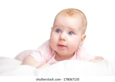 the little girl lies on a pillow - cloud. isolated on a white background.
