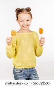 little girl with lollipops