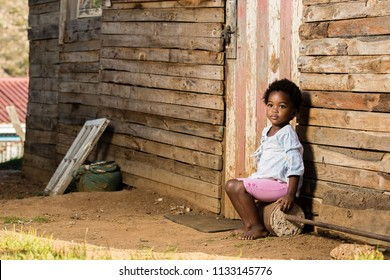 Little girl with a lonely  look on her face while looking past the camera