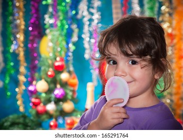 Little girl is looking forward to Christmas decorations