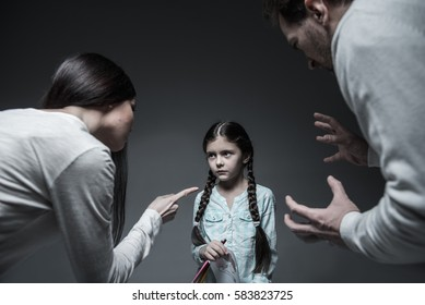 Little girl looking at her angry mother