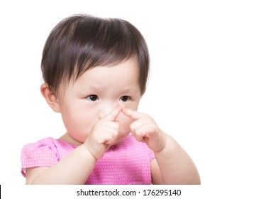 Little girl looking at her finger touch together