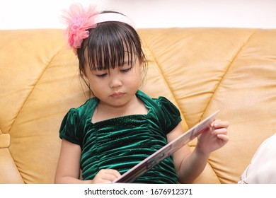 little girl looking the photo album