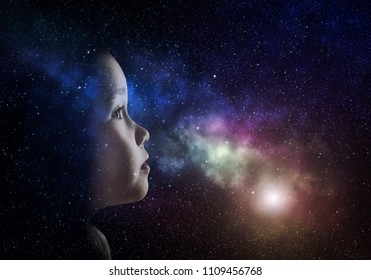 A little girl is looking at the sky